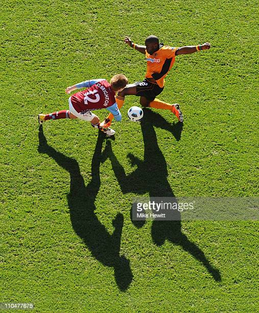 Marc Albrighton of Aston Villa and George Elokobi of Wolves battle for the ball during the Barclays Premier League match between Aston Villa and...