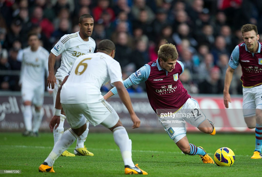 Marc Albrighton of Aston Villa challenges Ashley Williams of Swansea during the Barclays Premier League match between Swansea City and Aston Villa at Liberty Stadium on January 01, 2013 in Swansea, Wales.
