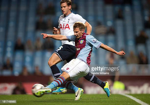 Marc Albrighton of Aston Villa is challenged by Jan Vertonghen of Tottenham Hotspur during the Capital One Cup Third Round match between Aston Villa...