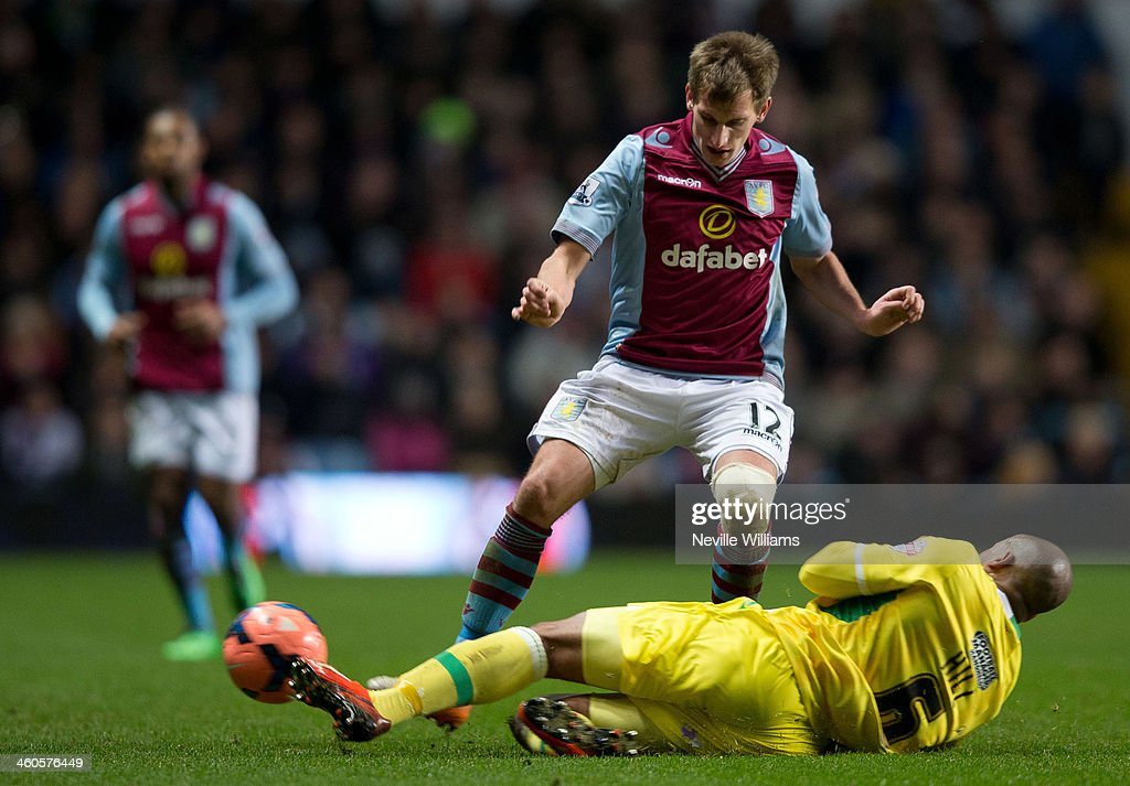 Marc Albrighton of Aston Villa is challenged by Matt Hill of Sheffield United during the FA Cup Third Round match between Aston Villa and Sheffield United at Villa Park on January 04, 2014 in Birmingham, England.