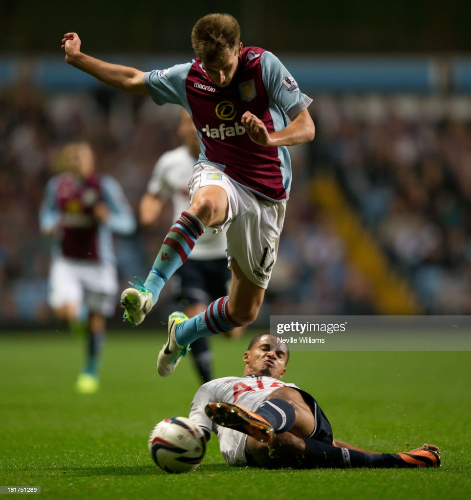 Marc Albrighton of Aston Villa is challenged by Zeki Fryers of Tottenham Hotspur during the Capital One Cup Third Round match between Aston Villa and Tottenham Hotspur at Villa Park on September 24, 2013 in Birmingham, England.