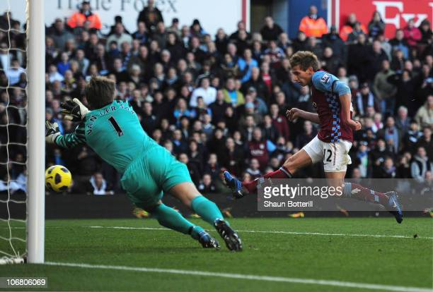 Marc Albrighton of Aston Villa scores his team's second goal past goalkeeper Edwin Van Der Sar of Manchester United during the Barclays Premier...