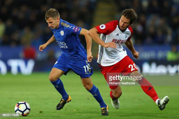 Marc Albrighton of Leicester City and Grzegorz Krychowiak of West Bromwich Albion in action during the Premier League match between Leicester City...