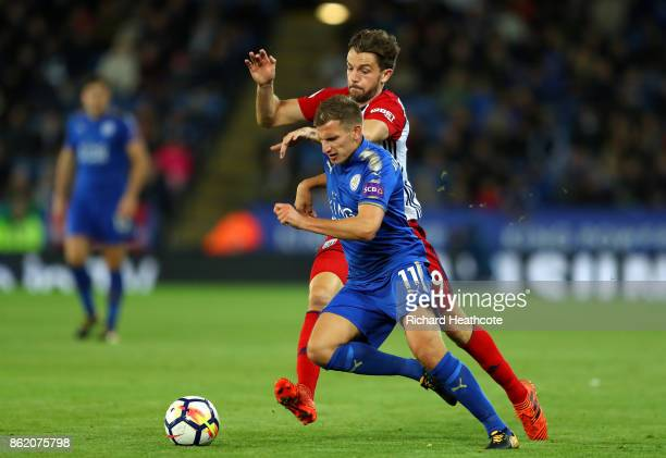 Marc Albrighton of Leicester City and Jay Rodriguez of West Bromwich Albion battle for possession during the Premier League match between Leicester...