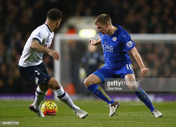 Marc Albrighton of Leicester City and Kyle Walker of Tottenham Hotspur compete for the ball during the Barclays Premier League match between...