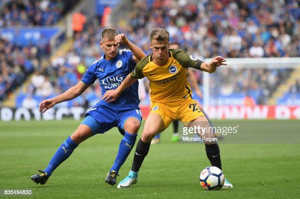 Marc Albrighton of Leicester City and Solly March of Brighton and Hove Albion during the Premier League match between Leicester City and Brighton and...