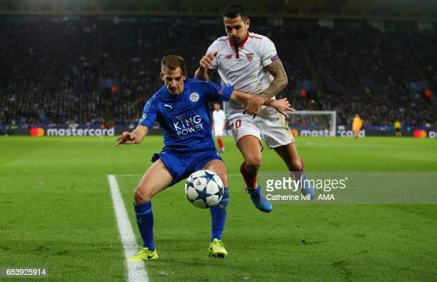 Marc Albrighton of Leicester City and Vitolo of Sevilla during the UEFA Champions League Round of 16 second leg match between Leicester City and...