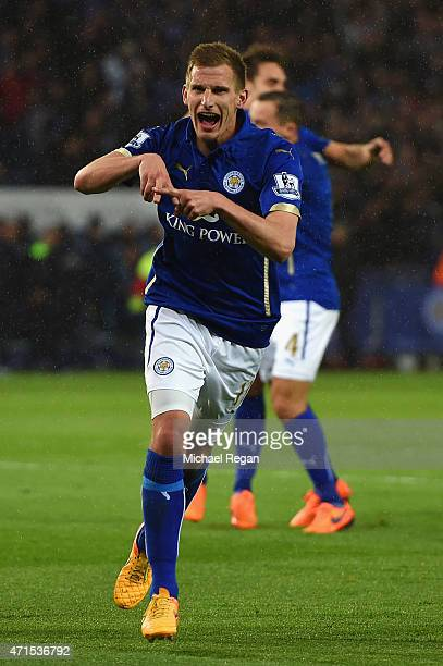 Marc Albrighton of Leicester City celebrates scoring the opening goal during the Barclays Premier League match between Leicester City and Chelsea at...