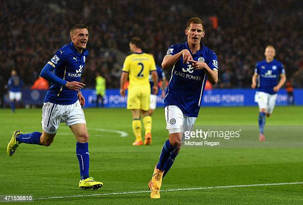 Marc Albrighton of Leicester City celebrates scoring the opening goal with Jamie Vardy of Leicester City during the Barclays Premier League match...