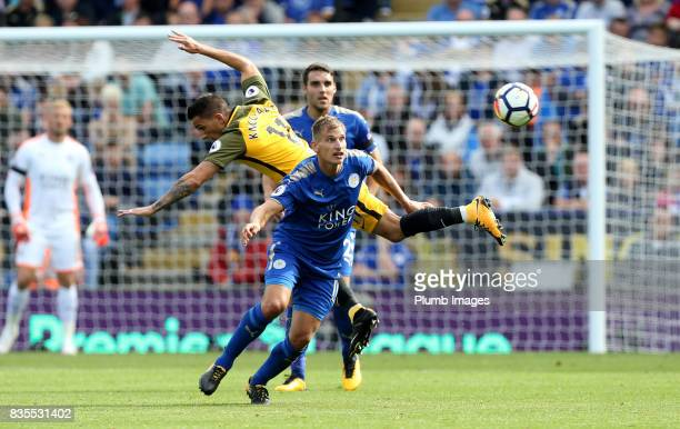 Marc Albrighton of Leicester City in action with Anthony Knockhaert of Brighton and Hove Albion during the Premier League match between Leicester...