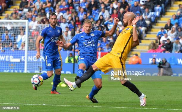 Marc Albrighton of Leicester City in action with Bruno of Brighton and Hove Albion during the Premier League match between Leicester City and...