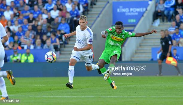 Marc Albrighton of Leicester City in action with Ibrahima Traore of Borussia Monchengladbach during the Leicester City v Borussia Monchengladbach...