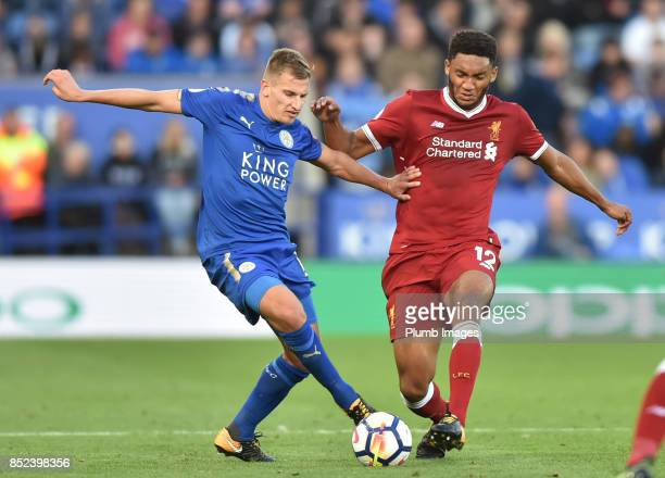 Marc Albrighton of Leicester City in action with Joe Gomez of Liverpool during the Premier League match between Leicester City and Liverpool at King...