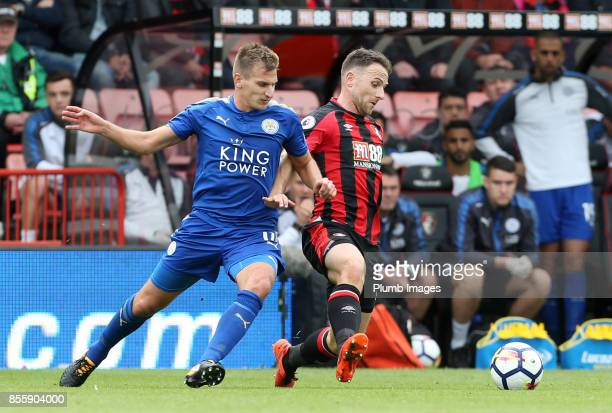 Marc Albrighton of Leicester City in action with Marc Pugh of Bournemouth during the Premier League match between Bournemouth and Leicester City at...