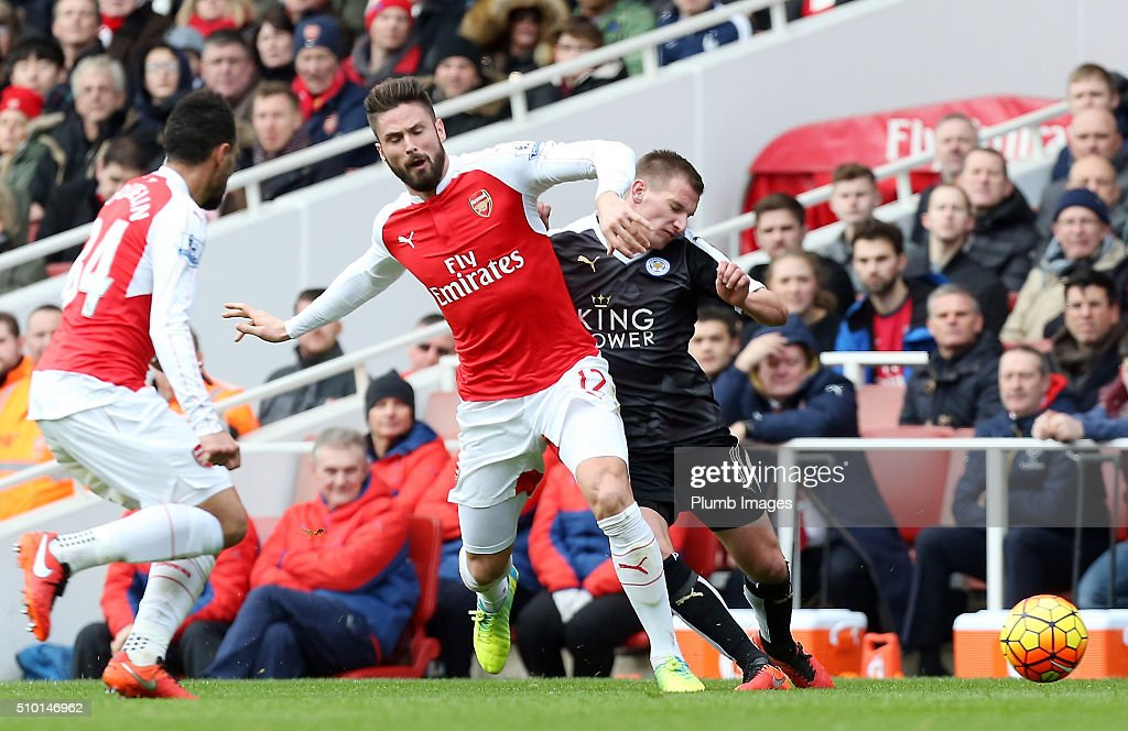 Marc Albrighton of Leicester City in action with Olivier Giroud of Arsenal during the Premier League match between Arsenal and Leicester City at Emirates Stadium on February 14, 2016 in London, United Kingdom.