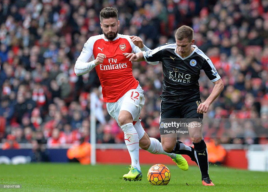 Marc Albrighton of Leicester City in action with <a gi-track='captionPersonalityLinkClicked' href=/galleries/search?phrase=Olivier+Giroud&family=editorial&specificpeople=5678034 ng-click='$event.stopPropagation()'>Olivier Giroud</a> of Arsenal during the Premier League match between Arsenal and Leicester City at Emirates Stadium on February 14, 2016 in London, United Kingdom.