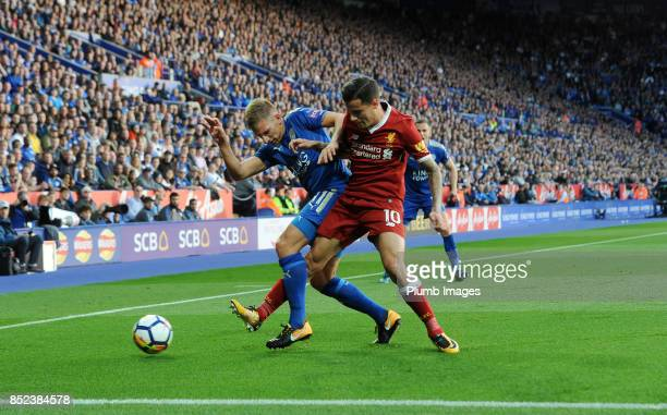 Marc Albrighton of Leicester City in action with Philippe Coutinho of Liverpool during the Premier League match between Leicester City and Liverpool...