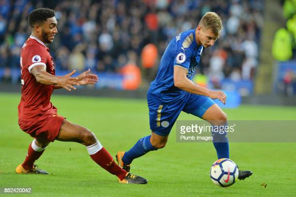 Marc Albrighton of Leicester City in action wth Joe Gomez of Liverpool during the Premier League match between Leicester City and Liverpool at The...