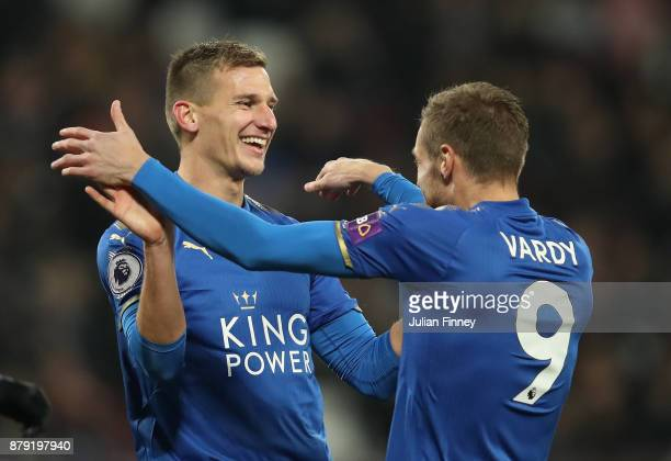 Marc Albrighton of Leicester City is congratulated by Jamie Vardy of Leicester City after he openned the scoring during the Premier League match...
