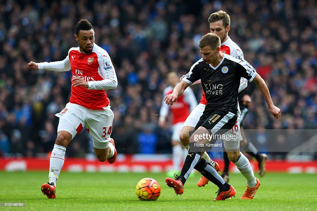 Marc Albrighton of Leicester City passes the ball under pressure from <a gi-track='captionPersonalityLinkClicked' href=/galleries/search?phrase=Francis+Coquelin&family=editorial&specificpeople=8957797 ng-click='$event.stopPropagation()'>Francis Coquelin</a> and <a gi-track='captionPersonalityLinkClicked' href=/galleries/search?phrase=Aaron+Ramsey&family=editorial&specificpeople=4784114 ng-click='$event.stopPropagation()'>Aaron Ramsey</a> of Arsenal during the Barclays Premier League match between Arsenal and Leicester City at Emirates Stadium on February 14, 2016 in London, England.