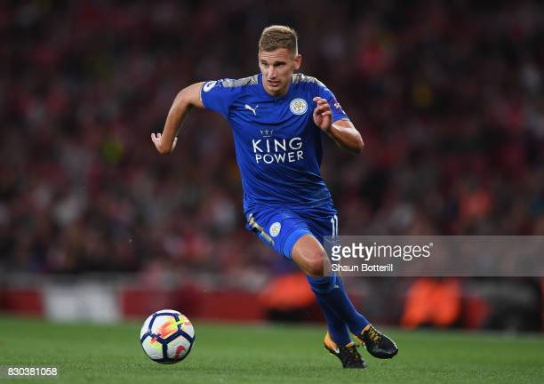 Marc Albrighton of Leicester City runs with the ball during the Premier League match between Arsenal and Leicester City at Emirates Stadium on August...