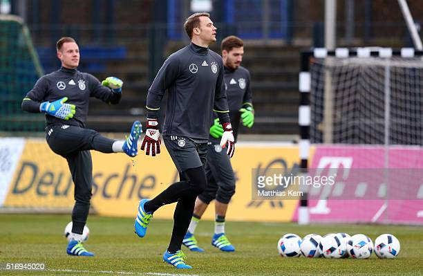 Marc Andre Ter Stegen Manuel Neuer and Kevin Trapp of Germany look on during a Germany training session ahead of their International frindly match...