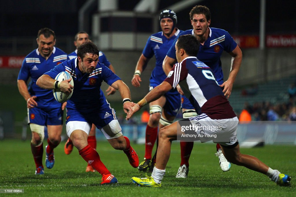 Marc Andreu of France makes a run at Jamison Gibson-Park of the Blues during the tour match between the Auckland Blues and France at North Harbour Stadium on June 11, 2013 in Auckland, New Zealand.