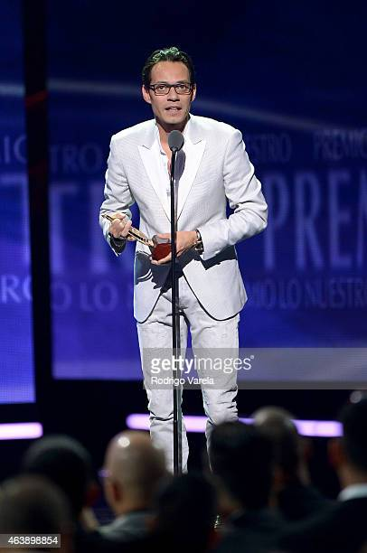 Marc Anthony accepts award onstage at the 2015 Premios Lo Nuestros Awards at American Airlines Arena on February 19 2015 in Miami Florida