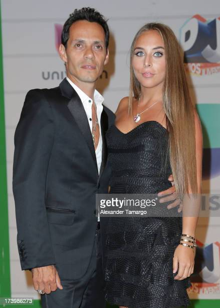 Marc Anthony and Chloe Green attend Univision's Premios Juventud 2013 at Bank United Center on July 18 2013 in Miami Florida