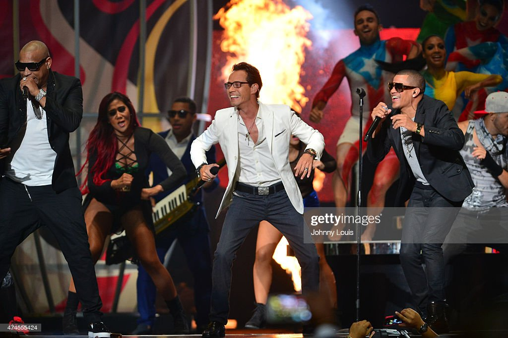 <a gi-track='captionPersonalityLinkClicked' href=/galleries/search?phrase=Marc+Anthony&family=editorial&specificpeople=202544 ng-click='$event.stopPropagation()'>Marc Anthony</a> and Gente de Zona performs at the 2015 Billboard Latin Music Awards presented by State Farm on Telemundo at Bank United Center on April 30, 2015 in Miami, Florida.