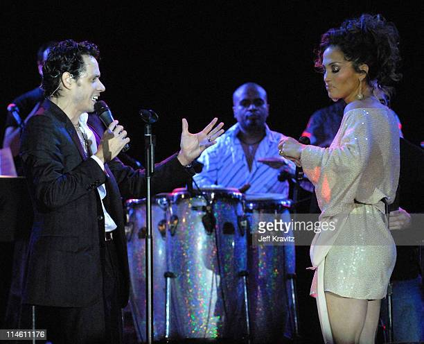 Marc Anthony and Jennifer Lopez during Marc Anthony and Jennifer Lopez in Concert February 3 2006 at Pontiac Garage Stage in Miami Beach Florida...