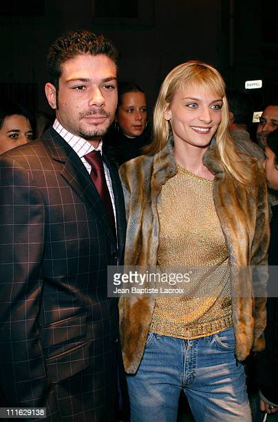 Marc Anthony and Sarah Marshall during Paris Fashion Week AutumnWinter 2003/2004 Moschino Opening Party at Moschino Shop in Paris France