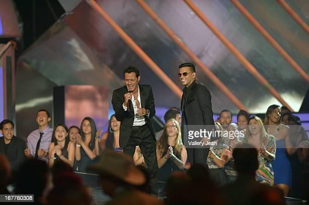 Marc Anthony and Tito El Bambino perform at Billboard Latin Music Awards 2013 at Bank United Center on April 25 2013 in Miami Florida