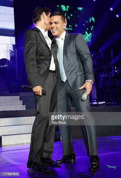Marc Anthony and Tito El Bambino perform during the Marc Anthony 'Vivir Mi Vida' concert at American Airlines Arena on August 23 2013 in Miami Florida