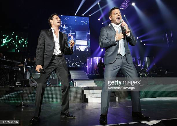Marc Anthony and Tito El Bambino perform during the 'Vivir Mi Vida' tour at American Airlines Arena on August 23 2013 in Miami Florida