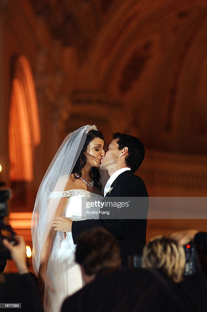 Marc Anthony and wife Dayanara Torres, 1993 Miss Universe, kiss after leaving the Old San Juan Cathedral during their Catholic wedding December 7, 2002 in San Juan, Puerto Rico.