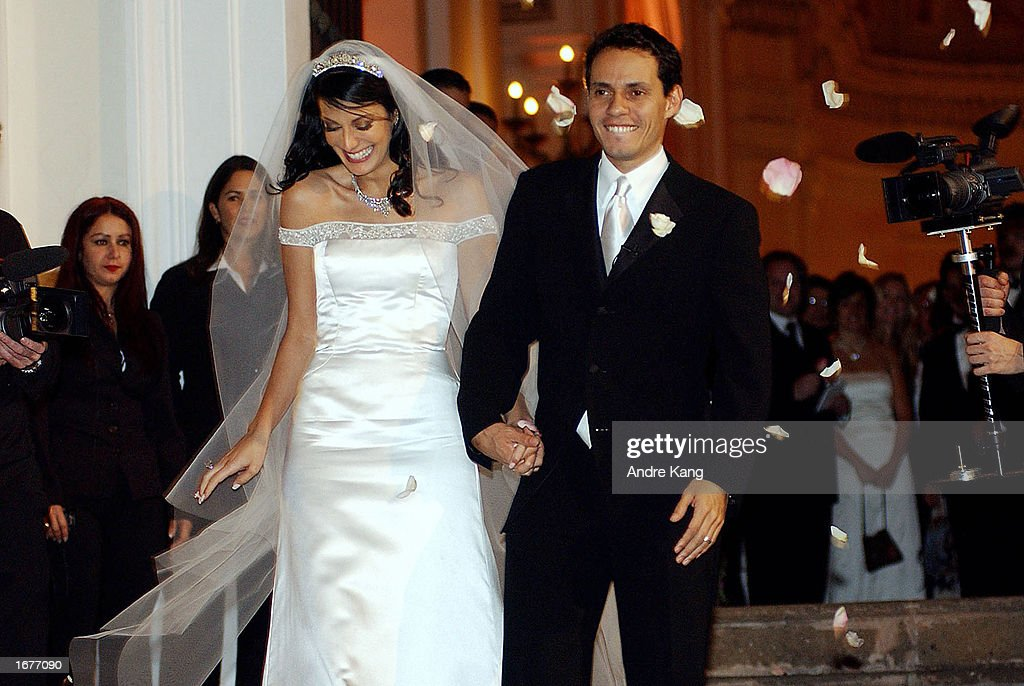 Marc Anthony and wife Dayanara Torres, 1993 Miss Universe, leave the Old San Juan Cathedral after their Catholic wedding December 7, 2002 in San Juan, Puerto Rico.