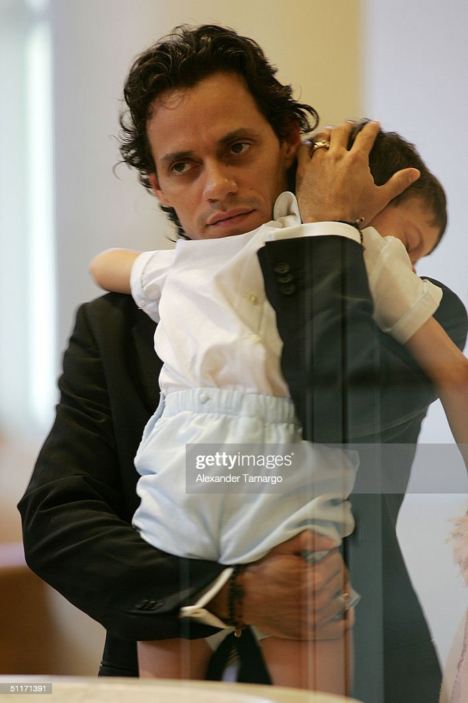 Marc Anthony holds son Cristian at his son Ryan's baptism ceremony at Saint Agatha's Church August 14, 2004 in Miami, Florida.