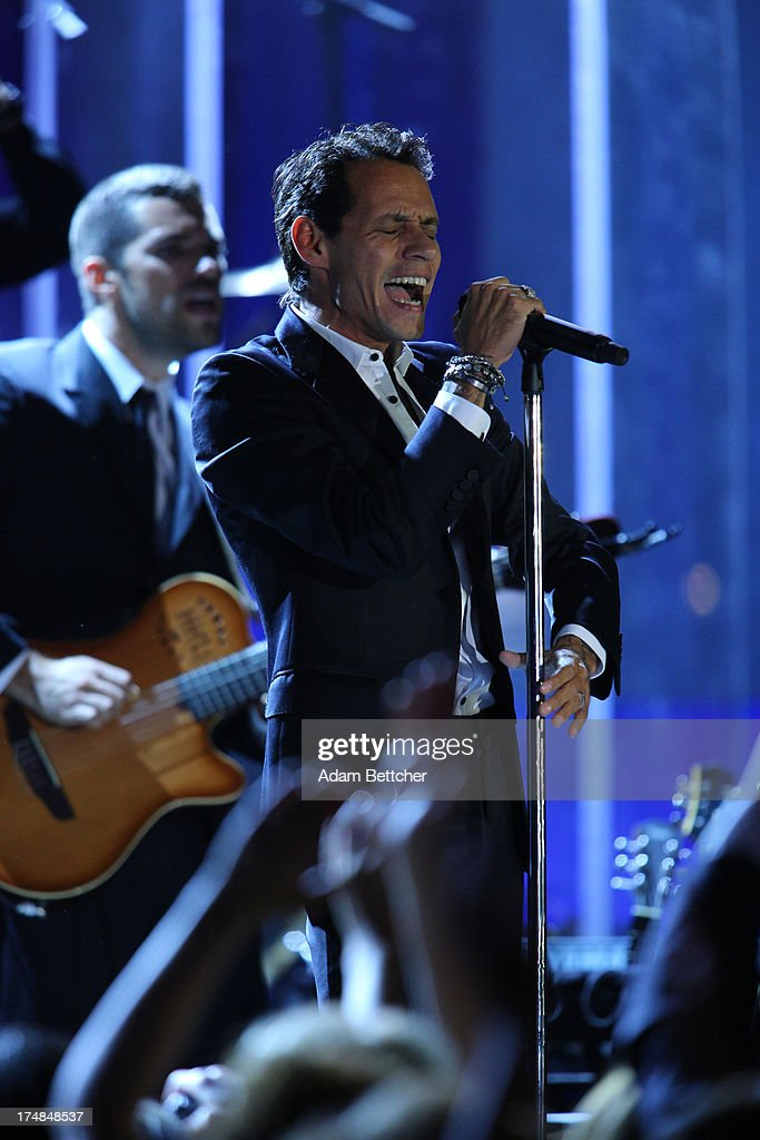 <a gi-track='captionPersonalityLinkClicked' href=/galleries/search?phrase=Marc+Anthony&family=editorial&specificpeople=202544 ng-click='$event.stopPropagation()'>Marc Anthony</a> performs during the 2013 Starkey Hearing Foundation's 'So the World May Hear' Awards Gala on July 28, 2013 in St. Paul, Minnesota.