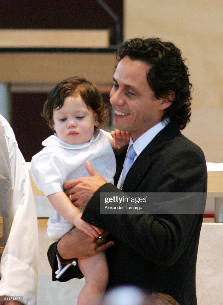Marc Anthony with baby Ryan at Ryan's baptism ceremony at Saint Agatha's Church on August 14, 2004 in Miami, Florida.