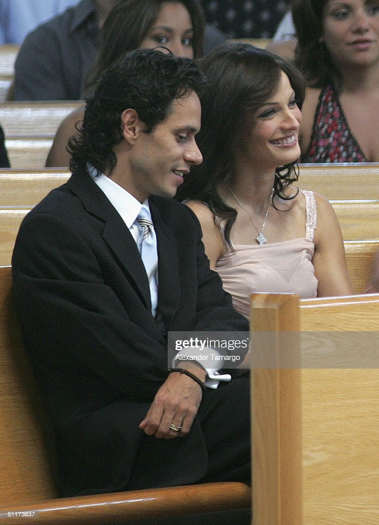 Marc Anthony with ex-wife Dayanara Torres at son Ryan's baptism ceremony at Saint Agatha's Church on August 14, 2004 in Miami, Florida.