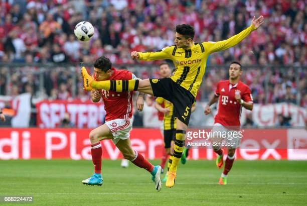 Marc Aregall Bartra of Dortmund challenges Robert Lewandowski of Bayern Muenchen during the Bundesliga match between Bayern Muenchen and Borussia...