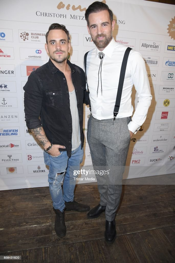 Marc Barthel and Christoph Metzelder attend the 'CMS Gamblers Night - Western Style' of Christoph Metzelder Foundation on October 6, 2017 in Berlin, Germany.