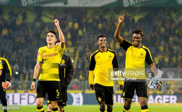 Marc Bartra Alexander Isak and DanAxel Zagadou of Borussia Dortmund celebrate the win after the final whistle during the Bundesliga match between...