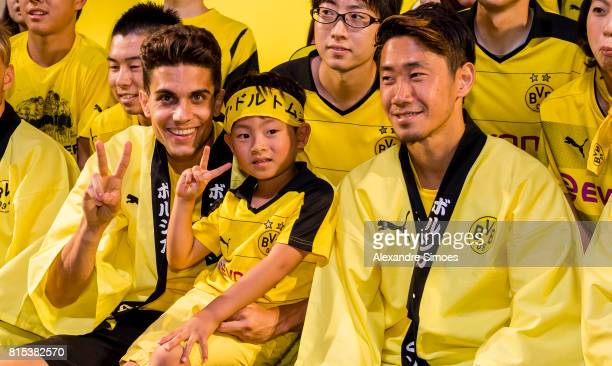 Marc Bartra and Shinji Kagawa of Borussia Dortmund together with their fans during the KAMO activity event at the PUMA Brand Center Tokyo on July 16...