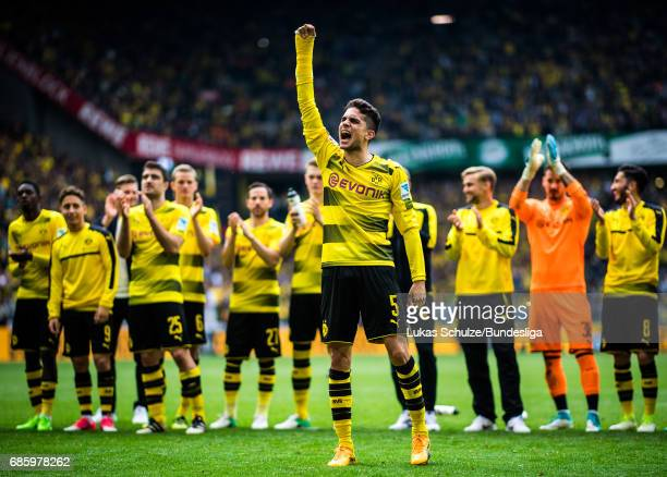 Marc Bartra and team mates celebrate their win after the Bundesliga match between Borussia Dortmund and Werder Bremen at Signal Iduna Park on May 20...