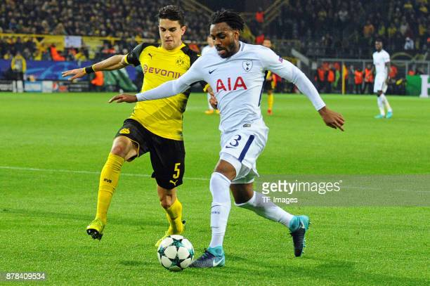 Marc Bartra Aregall of Borussia Dortmund and Danny Rose of Tottenham Hotspur battle for the ball during the UEFA Champions League group H match...
