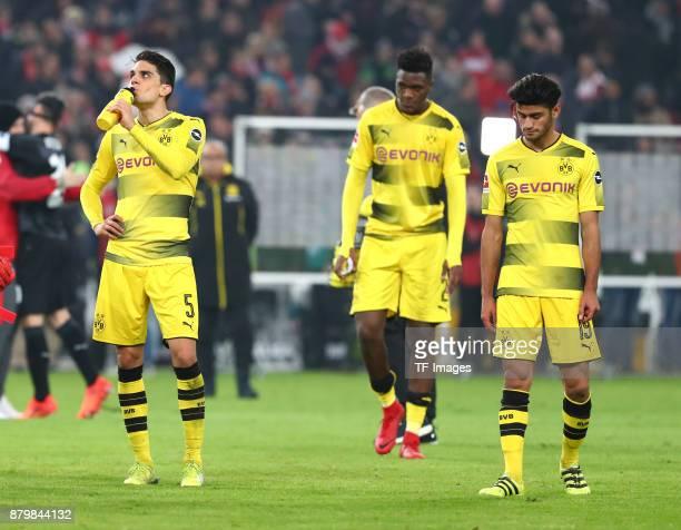 Marc Bartra Aregall of Dortmund DanAxel Zagadou of Dortmund and Mahmoud Dahoud of Dortmund look dejected after the Bundesliga match between VfB...