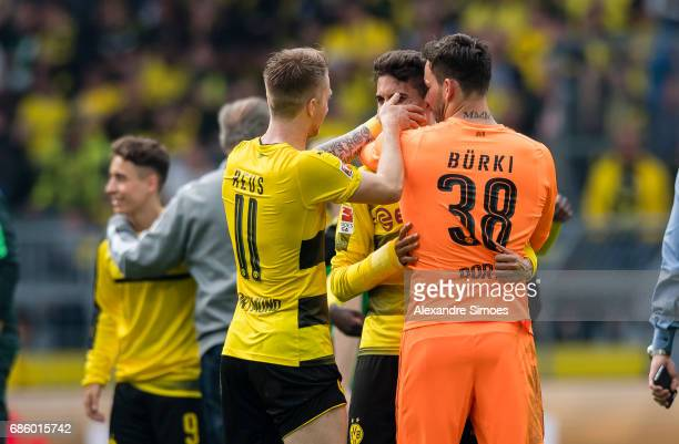 Marc Bartra Marco Reus and goal keeper Roman Buerki of Borussia Dortmund celebrate the win after the final whistle during the Bundesliga match...