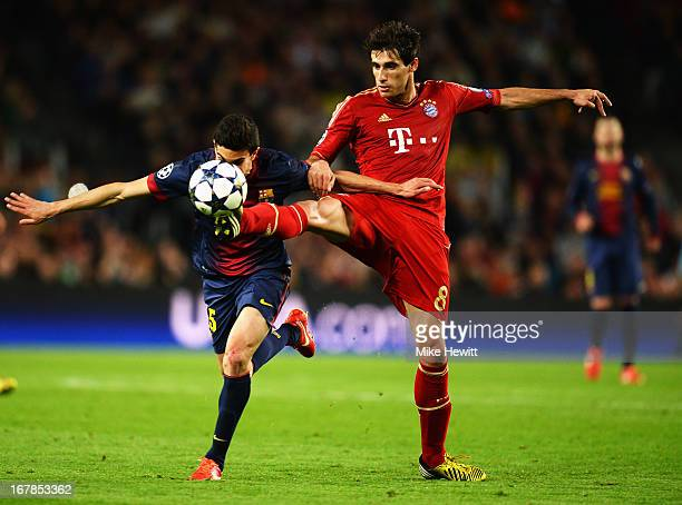 Marc Bartra of Barcelona and Javi Martinez of Munich challenge for the ball during the UEFA Champions League semi final second leg match between...